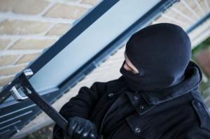 Man committing burglary