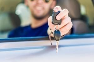 Man holding his car keys